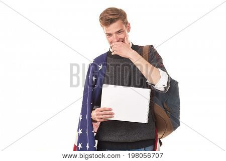 Portrait of male university student with American flag over his shoulders