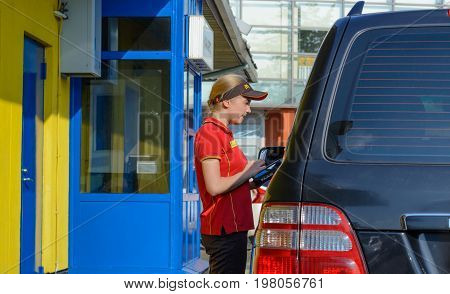 Moscow, Russia - August 2, 2017: Mcdonald's worker taking an order from customer in McDonald's drive thru service, McDonald's is an American fast food restaurant chain