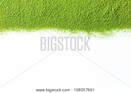 powdered green matcha tea on white background as image background