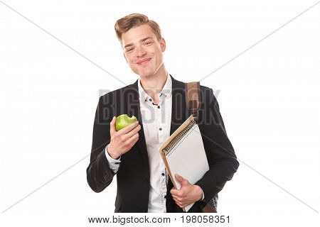 Portrait of handsome high school student posing in studio against white background