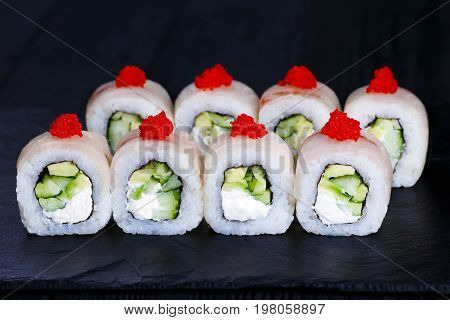 Sushi Roll With Cucumber And Cream Cheese, Covered With Grouper