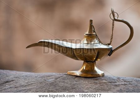 old arabian aladdin style lamp on the rocky ground of Jordan
