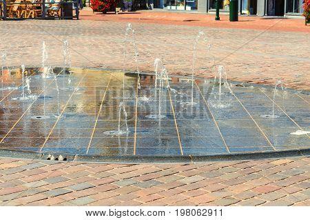 Fountain water play in a pedestrian zone.