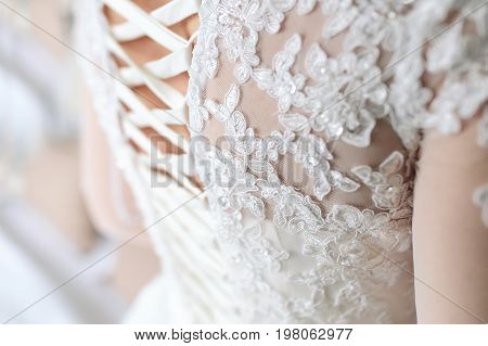 Image Of The Detailed Laces On The Back Of A Wedding Dress. Soft Fous On Lace