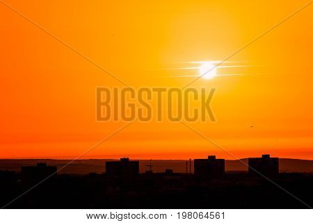 Photo of beautiful orange sunset on the city of Badajoz silhouette city in sunrise on seashore peaceful landscape sun down on town on warm weather heat concept
