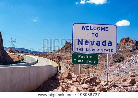 Welcome to Nevada sign next to Interstate 93 on the Nevada-Arizona border