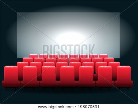 Cinema hall - red seats and a large screen for the projector