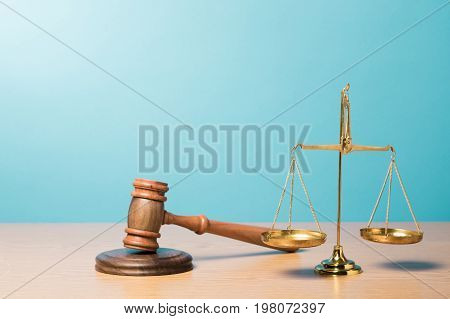 Justice scales gavel blue background paper isolated closeup