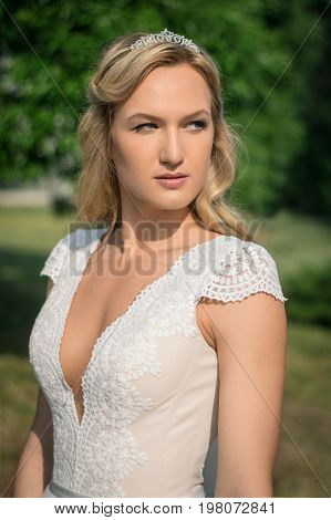 Beautiful bride outdoors in a forest. Wedding day
