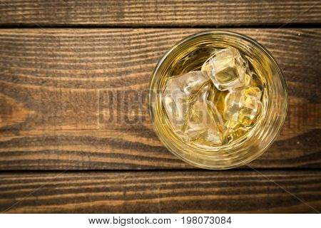 Glass ice whiskey table color pub background