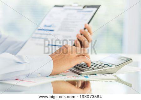 Business calculator stock market bank account ballpoint pen mathematical symbol white