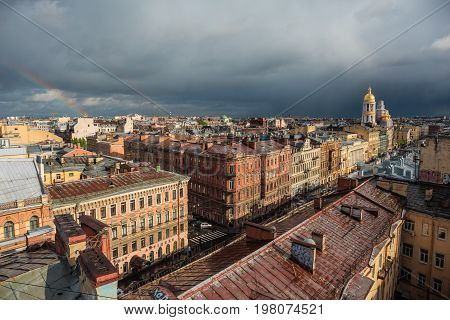 Houses in downtown center of Piter or St. Petersburg, panoramic view from rooftop in cloudy day