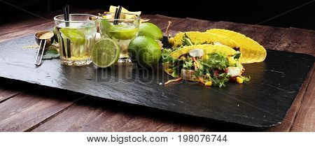 Caipirinha Of Brazil, Tacos And Delicious Nachos With Melted Cheese