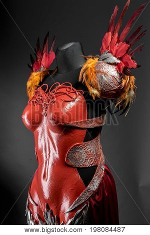 Praetorian, red armor for women with Roman helmet, adaptation of the classic style to one of fantasy.