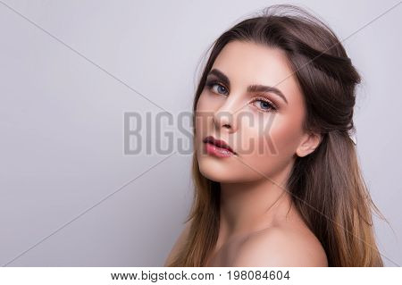 Fashionable portrait of a girl model. Fashion, glamour makeup. Freedom spring bright style lady, nude shoulders.