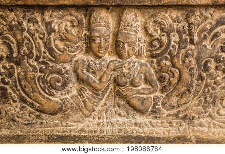 Symbol of love. Two bodies on carved wall relief made in circa 7th century. Artwork inside Hindu temple of Aihole, India.