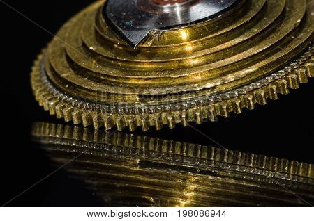 Watch Repair: Vintage Pocket Watch Fusee Cone Resting on a Black Surface