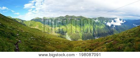 Panoramic view of Fagaras Mountain on summer part of the Carpathian Range from Romania