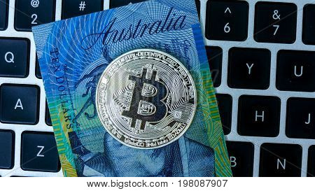 Bitcoin on Australian Dollar banknote. Electronic money exchange concept