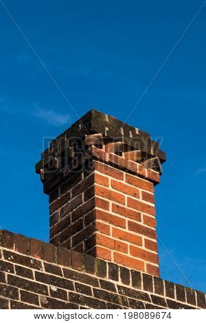 Detail Of Rooftop Red Brick Chimney In Tudor Architecture