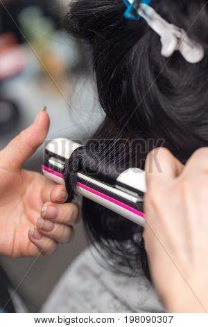Permanent hair in a beauty salon . A photo