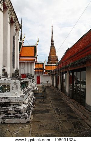 part of Beautiful Wat Phra Kaeo temple with orange and red roof in Thailand