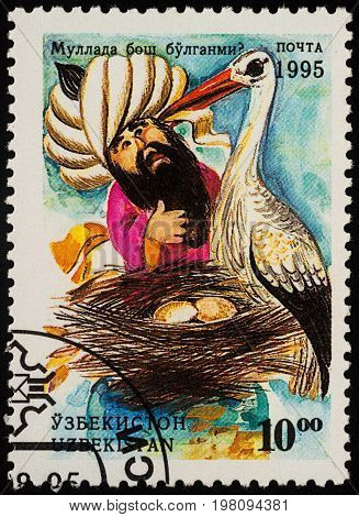 Moscow Russia - August 02 2017: A stamp printed in Uzbekistan shows scene from Asian fairy tale