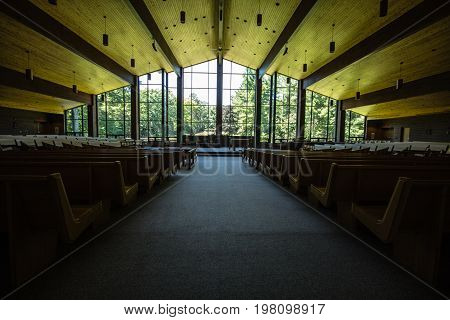 Indian River, Michigan, USA - July 26, 2017: Interior of the Catholic church at the Cross In The Woods Shrine in Northern Michigan.