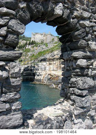 Looking through archway to ocean at Portofino, Italian Riviera