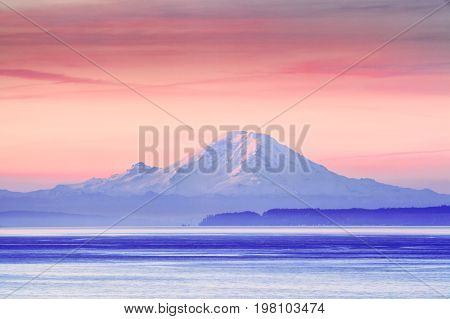 The Puget Sound at sunrise with Mount Rainier in the background, Washington, USA