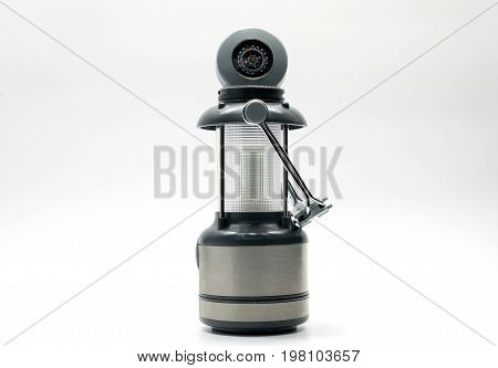 Camping lamp with black white and grey design isolated on white background compass handle