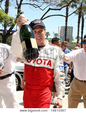 LOS ANGELES - APR 16:  William Fichtner, Winner of Race  celebrates at the Toyota Grand Prix Pro Celeb Race at the Toyota Grand Prix Track on April 16, 2011 in Long Beach, CA.
