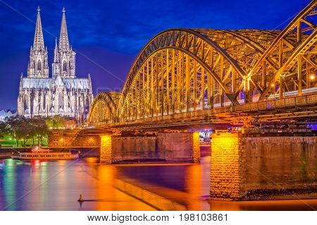 Cologne, Germany old town skyline at Cologne Cathedral and Hohenzollern Bridge.