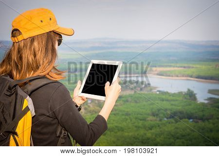 Close Up Tourist Young Woman  Looking Location On Tablet To The Mountain, Woman Reading Map. Tourism