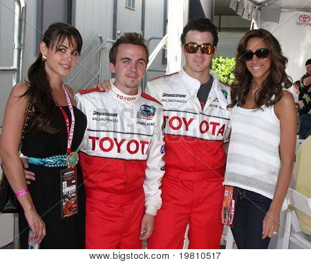 LOS ANGELES - APR 16:  Elycia Turnbow, Frankie Muniz, Kevin Jonas & wife Danielle attend the Toyota Grand Prix Pro Celeb Race at the Toyota Grand Prix Track on April 16, 2011 in Long Beach, CA.