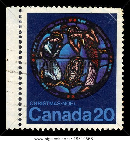 CANADA - CIRCA 1976: A stamp printed in Canada shows nativity scene by Yvonne Williams, stained glass in Canadian Museum of History, series Christmas (1976), circa 1976