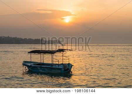 UNAWATUNA, SRI LANKA - DECEMBER 07. Pleasure craft early in the morning in the bay of Unawatuna on December 07, 2016. Vessel at anchor. The coastal village is one of the major tourist spots