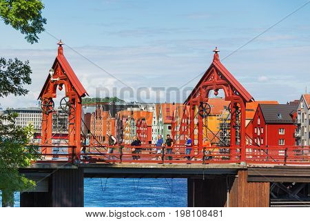 TRONDHEIM NORWAY - July 15 2017. Tourists walking on Gamle Bybro - The Old Town Bridge also known as Lykkens Portal (Portal of Happiness).