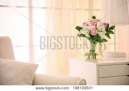 Beautiful bouquet with white freesia in modern room interior