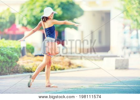 Beautiful Cute Young Girl Dancing On The Street From Happiness.cute Happy Girl In Summer Clothes Dan