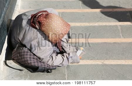 Elderly Gypsy Woman With Headscarves On Her Head And Long Skirt