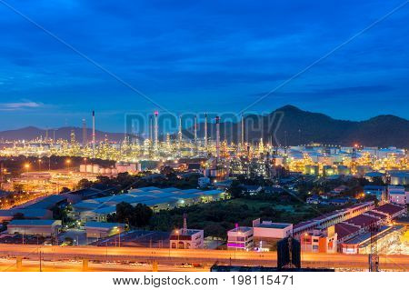 Oil refinery plant and illuminated at twilight.