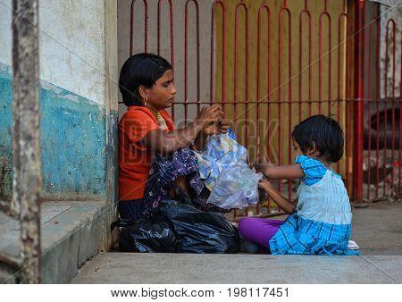 People Waiting At Train Station In Yangon, Myanmar