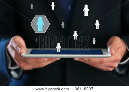 Man holding tablet, closeup. Concept of human resources management