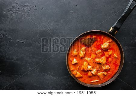 Frying Pan With Stewed Meat On A Black Background And Space For Text