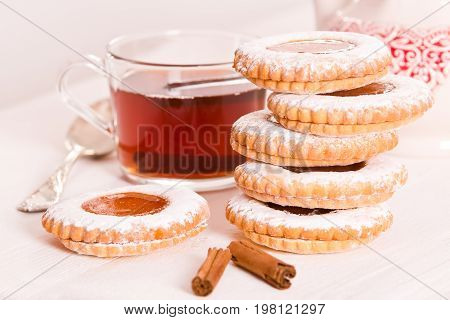 Teatime biscuits with cinnamon tea and jam.