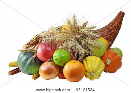 Thanksgiving Cornucopia full of harvested fruits and vegetables