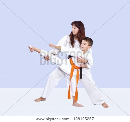 With black belt trainer teaches the athlete to hit a kick