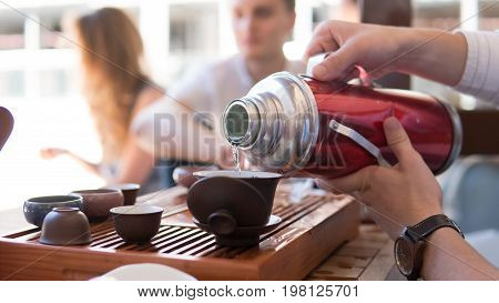 Brewing Chinese Tea In Ceramic Gaiwan During The Tea Ceremony Close-up. Gaiwan And Other Tea Tools F