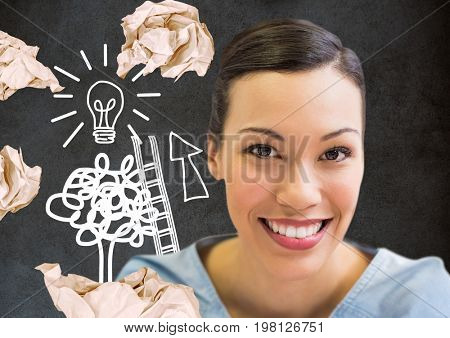 Digital composite of Woman standing next to light bulb drawings with crumpled paper balls in front of blackboard